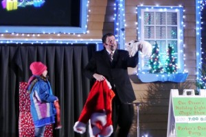 From Holiday Lights Show at Kennywood Park: The young girl inspected Santa's jacket and confirmed it didn't have any gifts hidden inside it. Apparently she missed the rabbit! (Photo credit: Barbara Flynn)